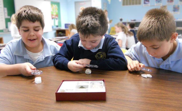 Nancy Larson Science 3 - Boys studying minerals