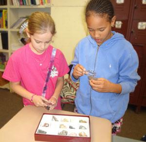 Students examining minerals