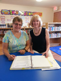 Principal Dr. Anna Adam (left) and Nancy Larson